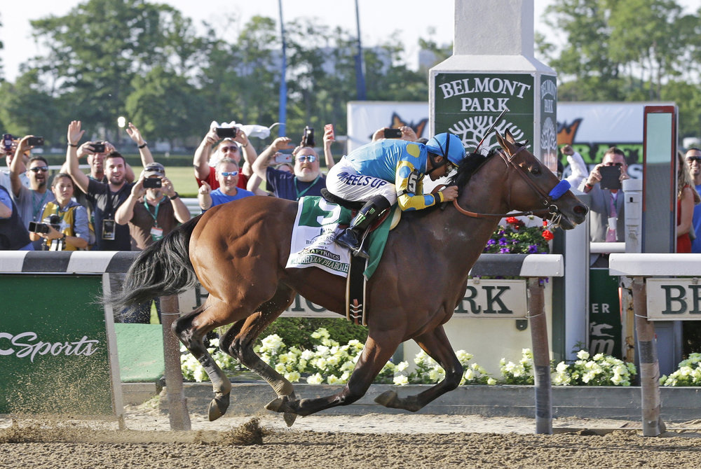American Pharoah crosses the finish line at Belmont Stakes to win the Triple Crown after 37 years.