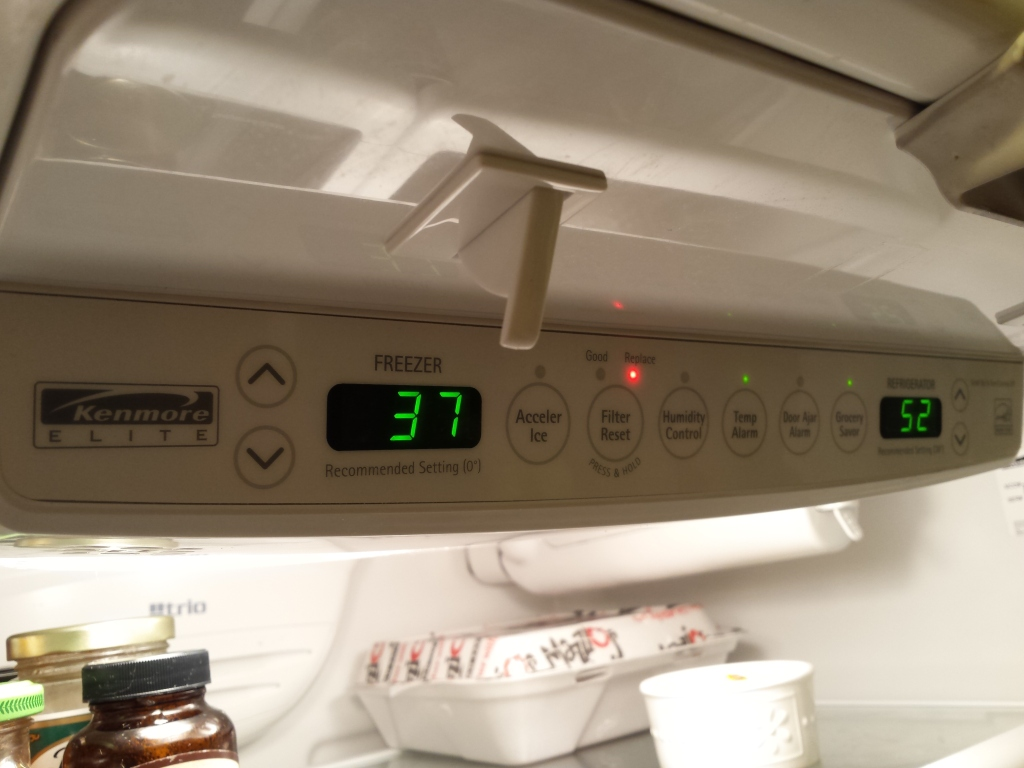 View of Kenmore Elite Trio refrigerator's control panel showing the digital temperatures at 37 F for Freezer and 52 F for frig.